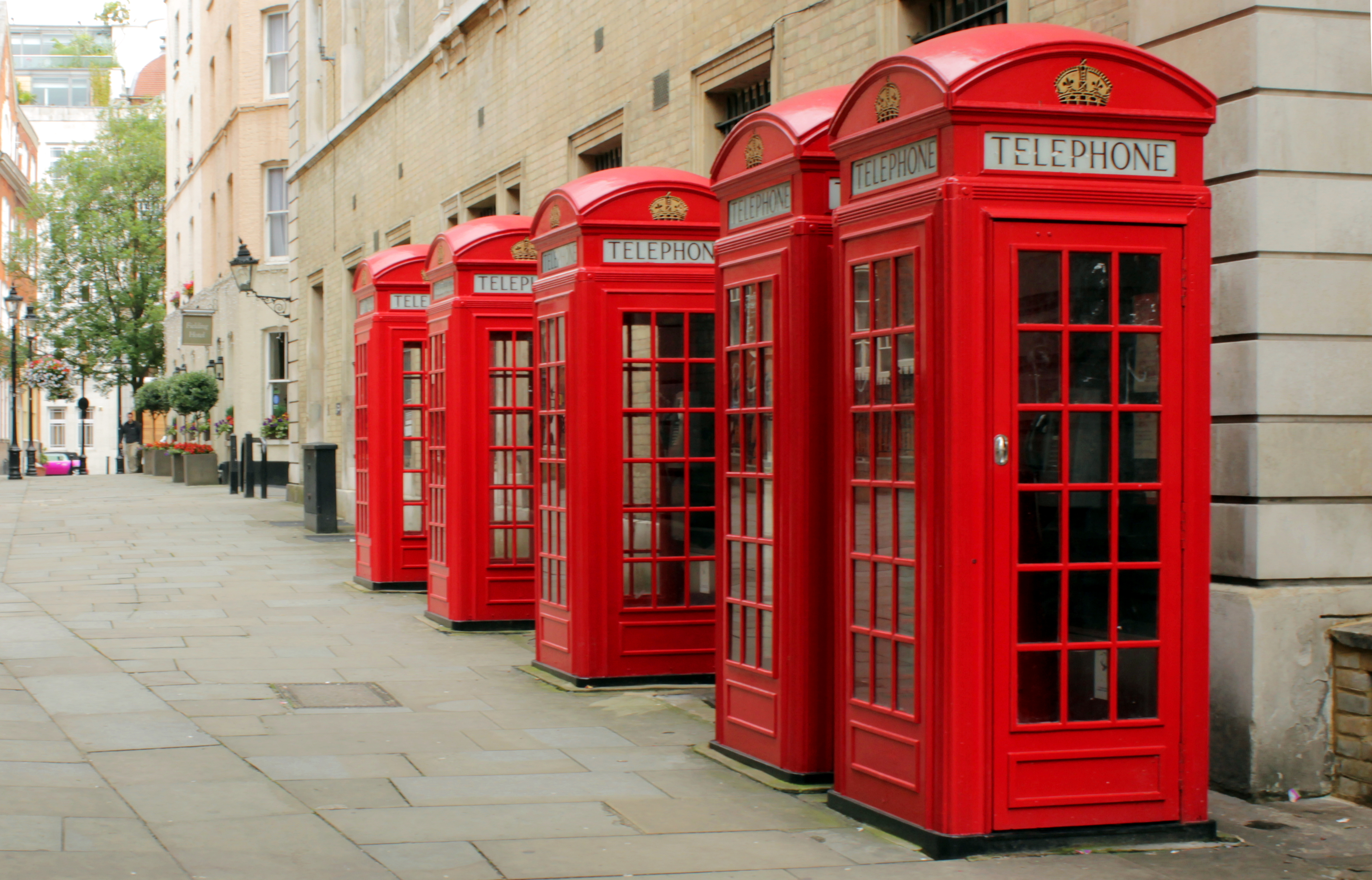 """""""Red Public Phone Boxes - Covent Garden, London, England - July 10, 2012"""" by M0tty - Own work. Licensed under CC BY-SA 3.0 via Wikimedia Commons."""