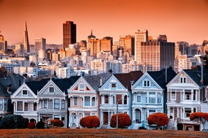 Victorian homes on Steine Street and the San Francisco skyline from Alamo Square Park
