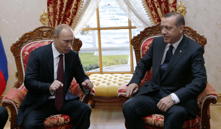 Russia's President Vladimir Putin (L) speaks with Turkey's Prime Minister Recep Tayyip Erdogan in Istanbul on December 3, 2012. Putin arrived in Istanbul on December 3 for a landmark visit due to focus on resolving differences with Turkey over the 20-month crisis in war-ravaged Syria. AFP PHOTO / POOL / TOLGA BOZOGLU (Photo credit should read TOLGA BOZOGLU/AFP/Getty Images)